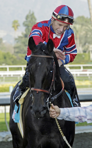 Russell Baze pats Bold Chieftain after riding the 7-year-old to victory in the $500,000 Sunshine Millions Classic horse race at Santa Anita Park in Arcadia, Calif., Saturday, Jan. 30, 2010.  (Reed ...