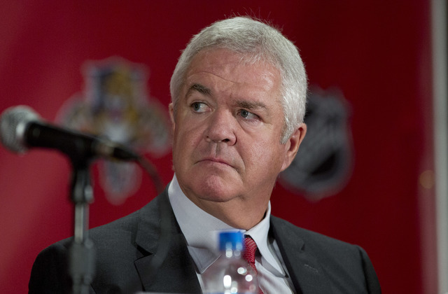 In this Sept. 27, 2013, file photo, Dale Tallon, the Florida Panthers' executive vice president and general manager, listens during an NHL hockey press conference in Sunrise, Fla. Tallon agrreed t ...