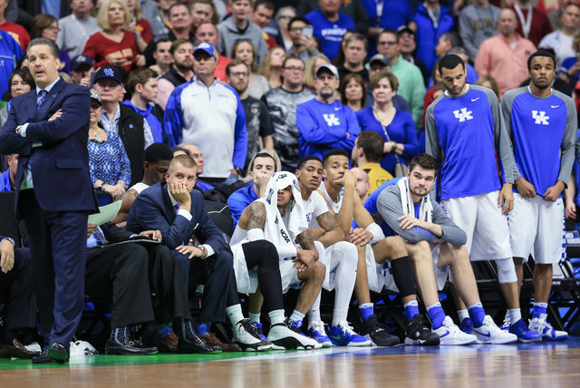 The Kentucky bench and coach John Calipari, left, follow the final seconds of a second-round men's college basketball game against Indiana in the NCAA Tournament in Des Moines, Iowa, Saturday, Mar ...