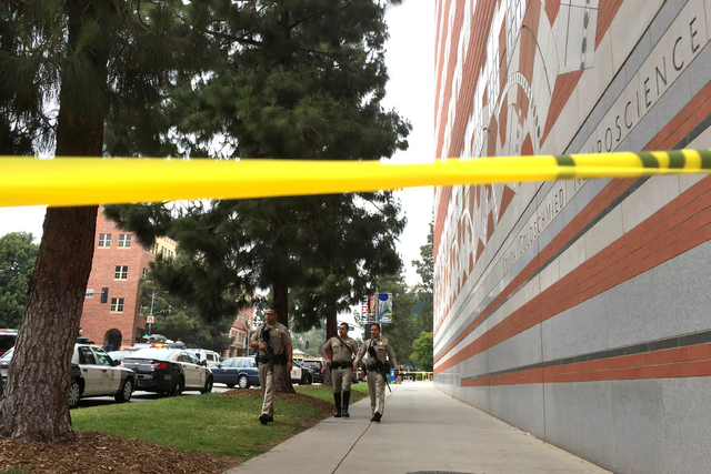Sheriff deputies work at the scene of a fatal shooting at the University of California, Los Angeles, Wednesday, June 1, 2016, in Los Angeles. (Ringo H.W. Chiu/AP)