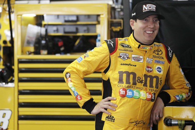 Kyle Busch smiles in his garage stall while waiting for a practice session for Sunday's NASCAR Sprint Cup Series auto race, Friday, June 3, 2016, in Long Pond, Pa. (AP Photo/Matt Slocum)