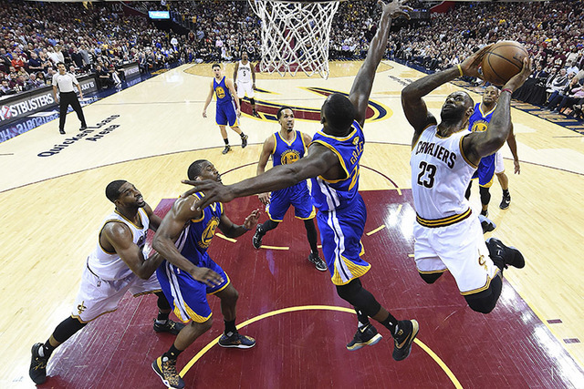 Cleveland Cavaliers forward LeBron James (23) drives to the basket against the Golden State Warriors during the first half of Game 3 of basketball's NBA Finals in Cleveland, Wednesday, June 8, 201 ...