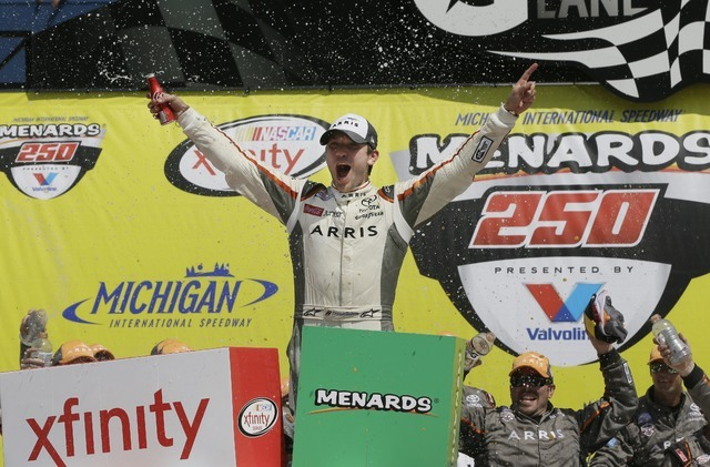Daniel Suarez yells after winning the NASCAR Xfinity series auto race at Michigan International Speedway, Saturday, June 11, 2016 in Brooklyn, Mich. The was the first win for Suarez. (AP Photo/Car ...