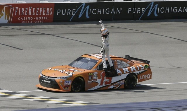 Daniel Suarez stands on his car and faces the fans after winning the NASCAR Xfinity series auto race at Michigan International Speedway, Saturday, June 11, 2016 in Brooklyn, Mich. The was the firs ...