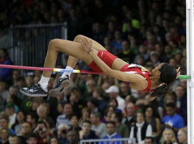 Vashti Cunningham clears the bar during the women's high jump final during the World Indoor Athletics Championships in Portland, Ore., March 20, 2016. Cunningham won the event. (Elaine Thompson/AP)