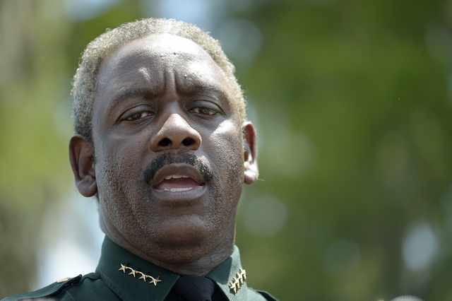 Orange County Sheriff Jerry Demings speaks to reporters during a news conference Wednesday, June 15, 2016, in Lake Buena Vista, Fla., after a toddler was dragged into the lake by an alligator Tues ...
