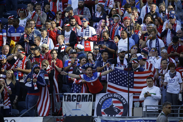 Fans of the United States cheer prior to a Copa America Centenario quarterfinal soccer match against Ecuador, Thursday, June 16, 2016 at CenturyLink Field in Seattle. (AP Photo/Ted S. Warren)