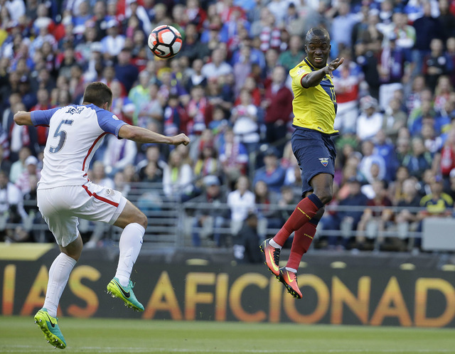 Ecuador's Enner Valencia, right, and United States' Matt Besler jump for the ball during a Copa America Centenario quarterfinal soccer match, Thursday, June 16, 2016 at CenturyLink Field in Seattl ...