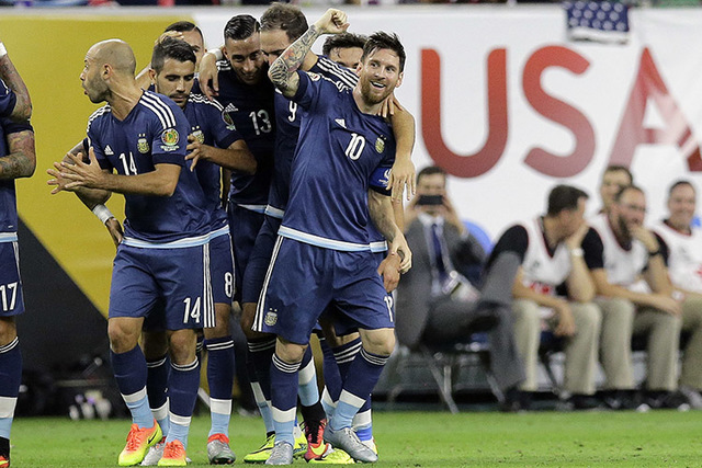 Argentina midfielder Lionel Messi (10) celebrates with teammates after his goal against the United States during a Copa America Centenario soccer semifinal, Tuesday, June 21, 2016, in Houston. (AP ...