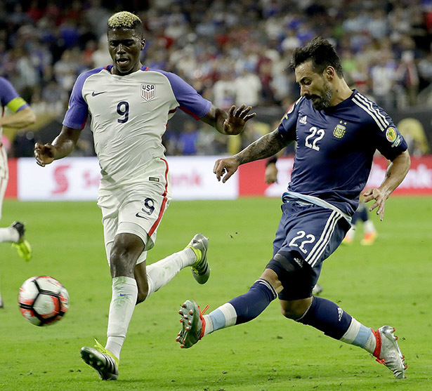 Argentina Ezequiel Lavezzi (22) kicks the ball past United States Gyasi Zerdes (9) during a Copa America Centenario semifinal soccer match Tuesday, June 21, 2016, in Houston. (AP Photo/David J. Ph ...