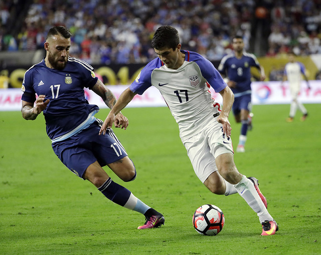 Argentina's Nicolas Otamendi (17) battles United States's Christian Pulisic (17) during a Copa America Centenario semifinal soccer match Tuesday, June 21, 2016, in Houston. (AP Photo/David J. Phillip)