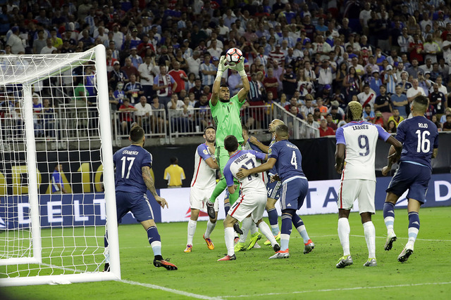 Argentina goalkeeper Sergio Romero (1) grabs a ball against the United States during a Copa America Centenario semifinal soccer match Tuesday, June 21, 2016, in Houston. (AP Photo/David J. Phillip)