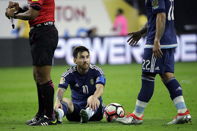 Argentina's Lionel Messi (10) is helped by teammate Ezequiel Lavezzi (22) during a Copa America Centenario semifinal soccer match against the United States, Tuesday, June 21, 2016, in Houston. (AP ...