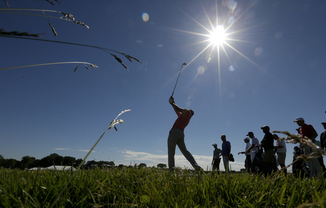 Jordan Spieth watches his tee shot on the eighth hole during a practice round for the U.S. Open golf championship at Oakmont Country Club on Tuesday, June 14, 2016, in Oakmont, Pa. (Charlie Riedel/AP)