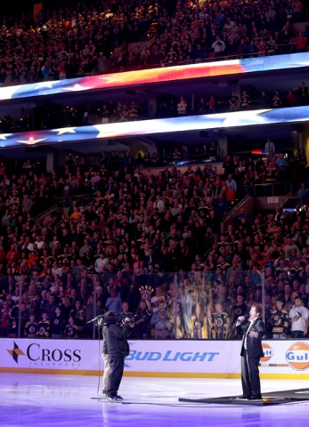 Rene Rancourt sings the national anthem before the start of an NHL game between the Boston Bruins and Montreal Canadiens at TD Garden in Boston, Saturday, Oct. 10, 2015. (AP Photo/Mary Schwalm)
