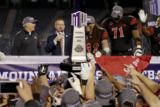 San Diego State players hold the trophy after the team's defeat of Air Force in the NCAA Mountain West Championship football game Saturday, Dec. 5, 2015, in San Diego. San Diego State won, 27-24.  ...