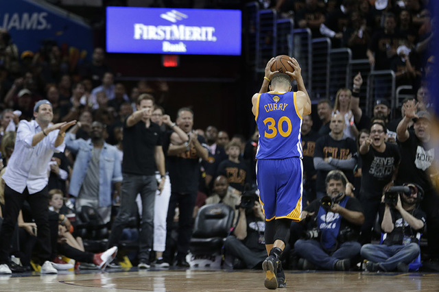 Golden State Warriors guard Stephen Curry (30) reacts to being called for a foul against the Cleveland Cavaliers  during the second half of Game 6 of basketball's NBA Finals in Cleveland, Thursday ...