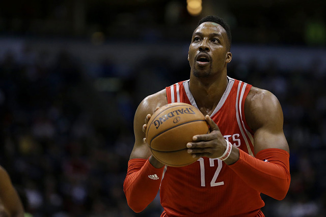 Houston Rockets' Dwight Howard shoots a free throw during the first half of an NBA basketball game against the Milwaukee Bucks Monday, Feb. 29, 2016, in Milwaukee. (Aaron Gash/AP)