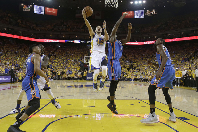 Golden State Warriors guard Stephen Curry (30) shoots against Oklahoma City Thunder forward Serge Ibaka (9) during the first half of Game 7 of the NBA basketball Western Conference finals in Oakla ...