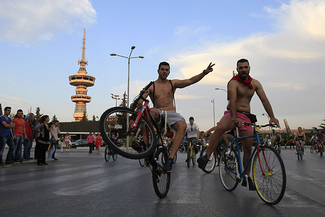Protesters some naked with their body painted during a bicycle protest in the northern port city of Thessaloniki, Greece, on Friday, June 7, 2013. More than 1,000 people took part in the ride, man ...