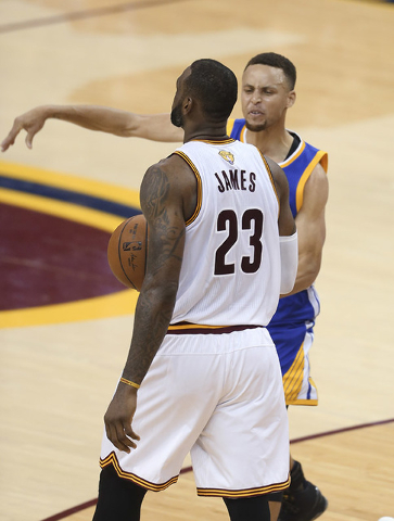 Golden State Warriors guard Stephen Curry reacts to being called for his sixth foul on Cleveland Cavaliers forward LeBron James (23) during the second half of Game 6 of basketball's NBA Finals in  ...