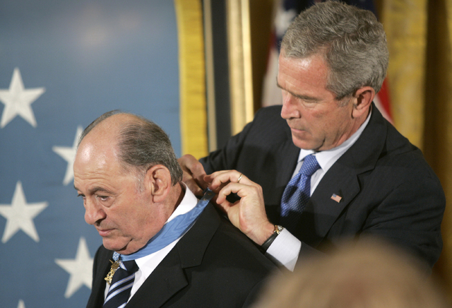 In this Sept. 23, 2005 file photo, President Bush presents the Medal of Honor to Cpl. Tibor Rubin, in the East Room at the White House.  (Lawrence Jackson/AP)