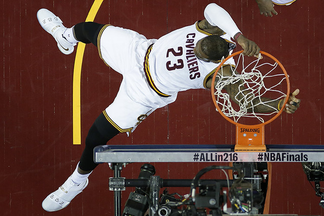 Cleveland Cavaliers forward LeBron James (23) dunks against the Golden State Warriors during the first half of Game 6 of basketball's NBA Finals in Cleveland, Thursday, June 16, 2016. (AP Photo/Ro ...
