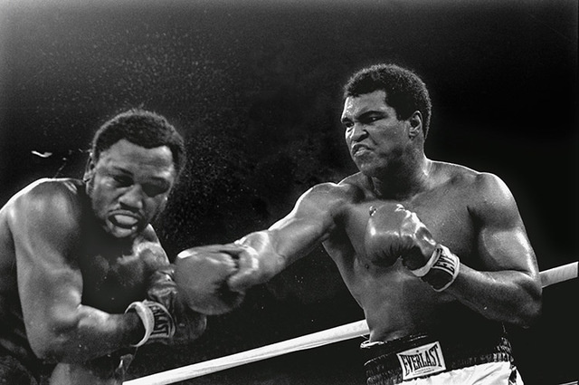 Spray flies from the head of challenger Joe Frazier as heavyweight champion Muhammad Ali connects with a right in the ninth round of their title fight in Manila, Philippines, October 1, 1975.  Ali ...