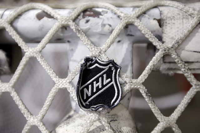 In this file photo taken Sept. 17, 2012, the NHL logo is seen on a goal at a Nashville Predators practice rink in Nashville, Tenn. (Mark Humphrey, file/Associated Press)