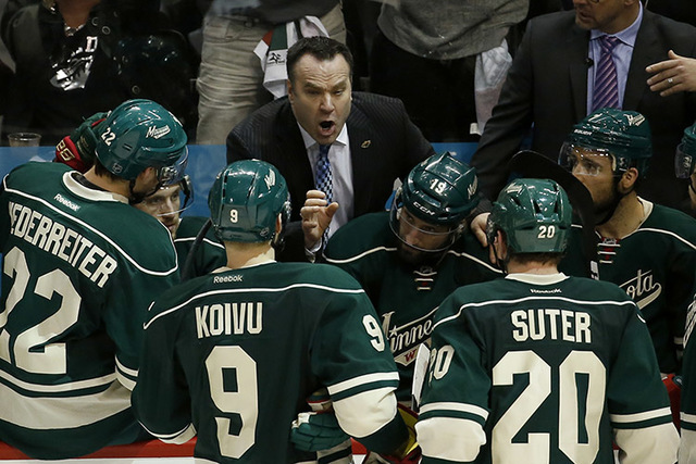 Minnesota Wild head coach John Torchetti talks with his players during the third period of Game 6 in the first round of the NHL Stanley Cup playoffs against the Dallas Stars in St. Paul, Minn., Su ...