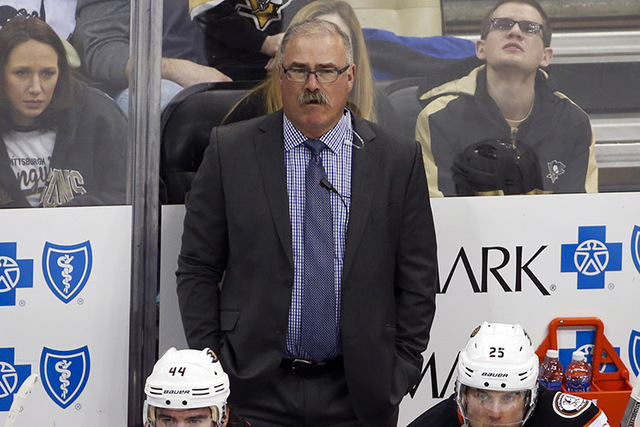 Anaheim Ducks assistant coach Paul MacLean stands behind his bench during an NHL hockey game against the Pittsburgh Penguins in Pittsburgh, Monday, Feb. 8, 2016. (Gene J. Puskar/AP)