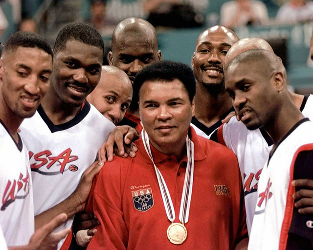 Muhammad Ali poses with Dream Team members  from left: Scottie Pippen, Hakeem Olajuwon, Reggie Miller, Shaquille O'Neal, Karl Malone and Gary Payton after receiving the gold medal, which replaces  ...