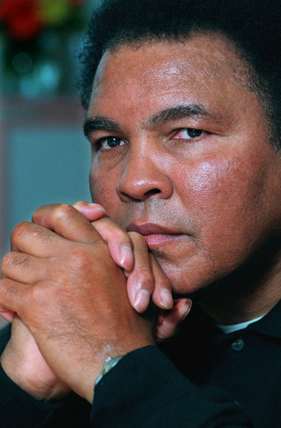 Boxing legend Muhammad Ali poses for a photo after an interview in New York, Tuesday Feb. 2, 1999. (Richard Drew/AP)