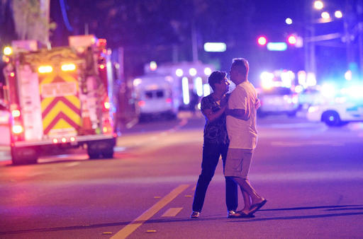 Family members wait for word from police after arriving down the street from a shooting involving multiple fatalities at Pulse Orlando nightclub in Orlando, Fla., Sunday, June 12, 2016. (Phelan M. ...