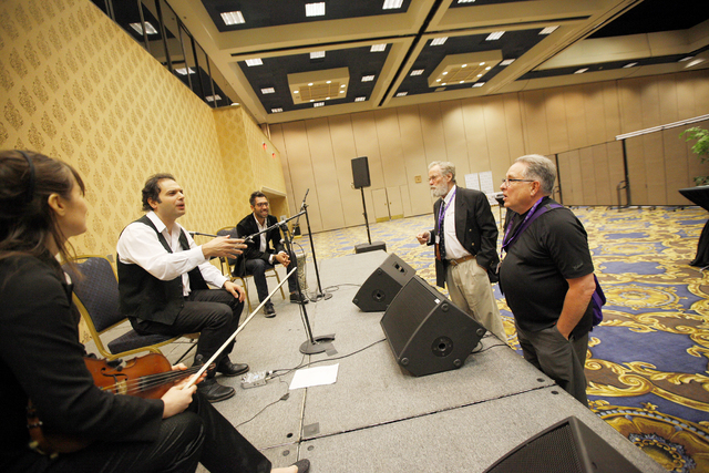 Dr. Laraine Kaizer-Viazovtsev, from left, Dr. Bishr Hijazi, and Charbel Azzi of the Arab Music Ensemble of Las Vegas talk to convention attendees Eddy Bayens, second from right, and Tony Cyre at t ...