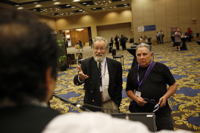 Convention attendees Eddy Bayens, left, and Tony Cyre talk to Dr. Bishr Hijazi of the Arab Music Ensemble of Las Vegas at the American Federation of Musicians Convention at the Westgate Pavilion o ...