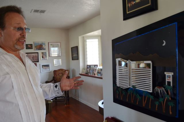 Dennis Drzyzga talks about his artwork depicting the Mirage inside his southwest Las Vegas home. Planning the work helped him heal after his wife's death. Ginger Meurer/Special to View