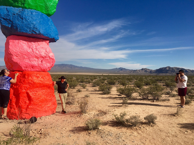 People take pictures at the Seven Magic Mountains art project off Interstate 15 on Sunday, June 5, 2016. (Natalie Bruzda/Las Vegas Review-Journal)
