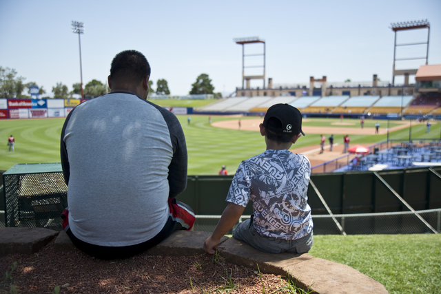 Jonathan Morales, left, and Alex Valdez stay cool in the shade during the Las Vegas 51s baseball game against the Tacoma Rainiers at Cashman Field on Tuesday, June 7, 2016. (Daniel Clark/Las Vegas ...