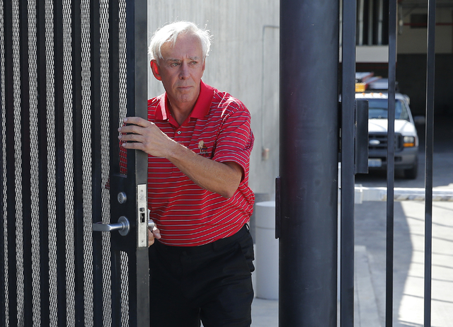 Bill Walters walks out of the Lloyd George U.S. Courthouse Thursday, May 19, 2016, in Las Vegas. Federal authorities in New York announced an insider trading indictment Thursday against Walters. ( ...
