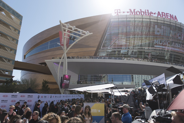 Attendees and press walk along the red carpet during the Billboard Music Awards at T-Mobile Arena in Las Vegas Sunday, May 22, 2016. (Jason Ogulnik/Las Vegas Review-Journal)