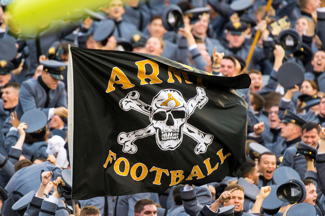 : The Army Black Knights flag waves proudly in front if the stands filled with cadets during the NCAA football game between the Army Black Knights and the Navy Midshipmen played at Lincoln Financi ...