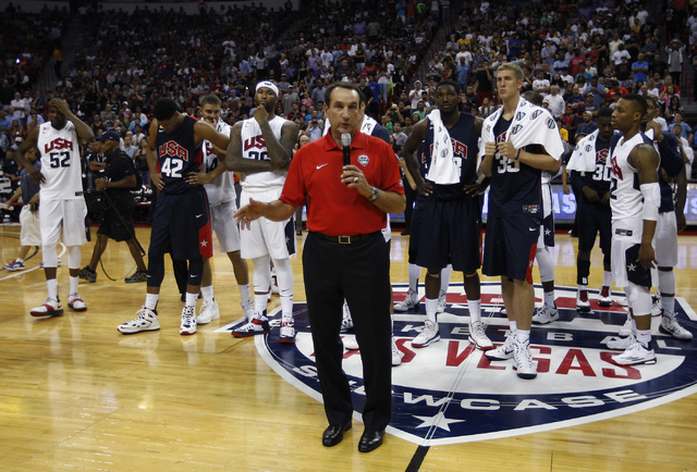 Head coach Mike Krzyzewski announces the premature end to the game after Paul George broke his leg during the USA Basketball Showcase intrasquad game at the Thomas & Mack Center in Las Vegas o ...