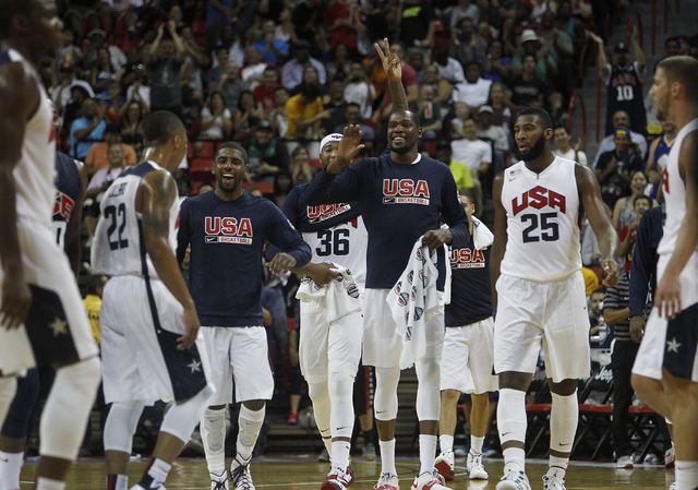 The white team celebrates after Damian Lillard (22) his a three quarter court shot to beat the half time buzzer during the USA Basketball Showcase intrasquad game at the Thomas & Mack Center i ...