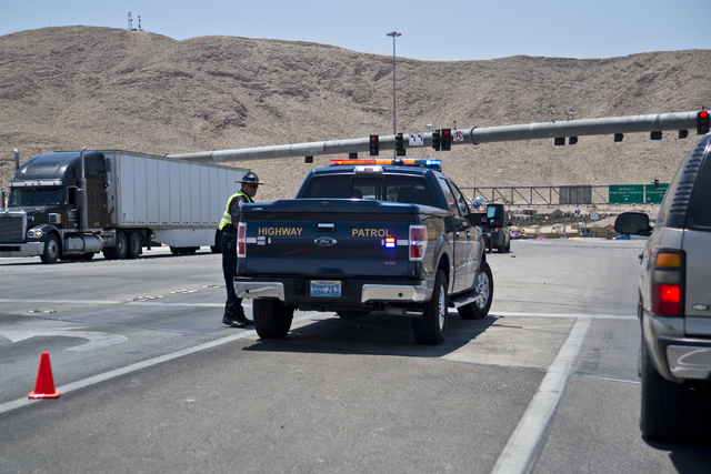 A police vehicle blocks the entrance to Interstate 15 at St. Rose Parkway in southeast Las Vegas on Wednesday, June 22, 2016. Interstate 15 was briefly shut down in both directions from St. Rose P ...