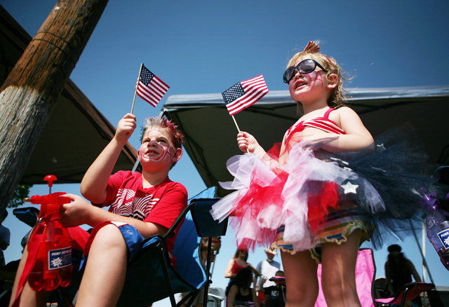 "Chase, 8, left, and Rainey Easter, 2, watch the 66th Annual Boulder City Damboree Celebration ""Wings of Freedom"" parade Friday, July 4, 2014, in Boulder City. The parade, which i ..."