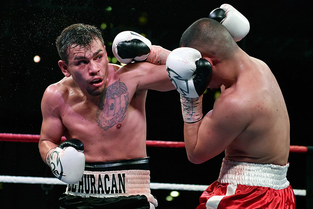 Jesus Gutierrez, left, connects with Angel Hernandez during their lightweight fight at the the Downtown Las Vegas Events Center in Las Vegas on Friday, May 22, 2015. The bout was declared a majori ...