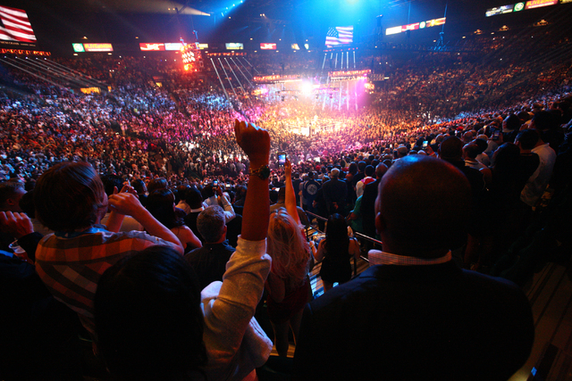 Fans cheer at the start of the welterweight unification boxing match between Floyd Mayweather Jr. and Manny Pacquiao at the MGM Grand Garden Arena in Las Vegas on Saturday, May 2, 2015. (Chase Ste ...