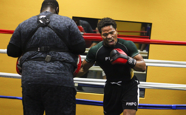 Shawn Porter, right, works out at Porter Hy-Performance Center, 2206 Paradise Road, in Las Vegas on Wednesday, June 8, 2016. Porter is slated to fight Keith Thurman on June 25. (Loren Townsley/Las ...