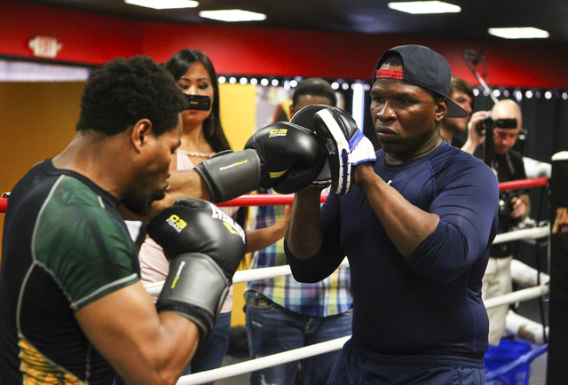 Shawn Porter, left, trains with his father, Kenny Porter, at Porter Hy-Performance Center, 2206 Paradise Road, in Las Vegas on Wednesday, June 8, 2016. Porter is slated to fight Keith Thurman on J ...